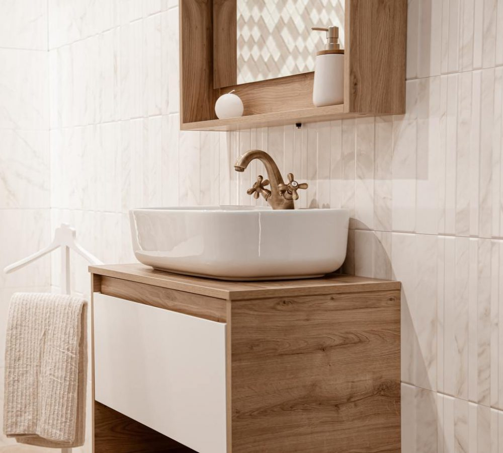 Cozy interior of the bathroom with a beautiful sink.